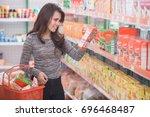 attractive asian woman shopping ... | Shutterstock . vector #696468487