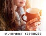Stock photo tea time beautiful blonde woman holding ceramic cup of tea or coffee enjoy closeup looking at 696488293