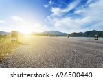asphalt road with reservoir and ... | Shutterstock . vector #696500443
