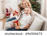 beautiful mature woman and kids ... | Shutterstock . vector #696504673