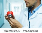cardiologist checking red heart ... | Shutterstock . vector #696532183