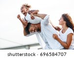 young mixed race family hangout ... | Shutterstock . vector #696584707