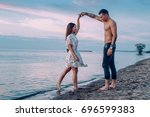 couple in love on the beach | Shutterstock . vector #696599383