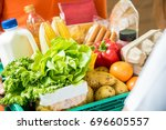 delivery man delivering food to ... | Shutterstock . vector #696605557