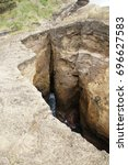 Small photo of Wide and deep rock crevice with surge inside, in the rim of volcanic crater island Ilheu de Vila Franca do Campo, Sao Miguel, Azores, Portugal, 2010