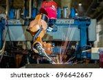 robot welding is welding... | Shutterstock . vector #696642667