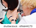 the dermatologist examines the... | Shutterstock . vector #696644173