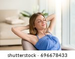 woman relaxed sitting in chair... | Shutterstock . vector #696678433