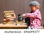 a little boy is playing office  ...   Shutterstock . vector #696699277