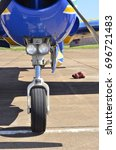 Small photo of Blue aircraft landing gear front view