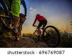 mountain biking women and man... | Shutterstock . vector #696769087