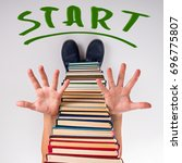 Small photo of Unusual funny education concept with book boy starting in new academic year