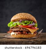 fresh tasty burger on wood table | Shutterstock . vector #696796183