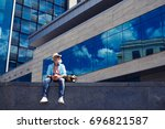 wide shot of male in jeans and... | Shutterstock . vector #696821587