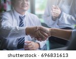 business team working on... | Shutterstock . vector #696831613
