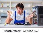 computer repairman repairing... | Shutterstock . vector #696855667