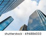 a group of modern skyscrapers... | Shutterstock . vector #696886033