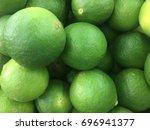 lime citrus fruits in fruit...   Shutterstock . vector #696941377