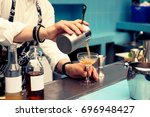 bartender is pouring cocktail... | Shutterstock . vector #696948427
