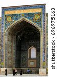 Small photo of SAMARCAND, UZBEQUISTAN - MAY 26 2011: Beautiful aithentic blue tile architecture with local people