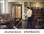 cleaning the hotel lounge  | Shutterstock . vector #696986653