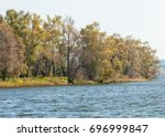 fall river. autumn colorful... | Shutterstock . vector #696999847
