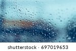close up rain drops on car... | Shutterstock . vector #697019653
