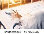 rear view of business asian man ... | Shutterstock . vector #697023607