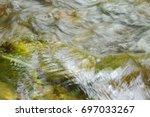 River Flowing Leaf Stuck On...