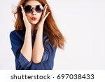 beautiful young woman in... | Shutterstock . vector #697038433