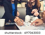 financial adviser working with... | Shutterstock . vector #697063003