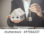 house keys and model house...   Shutterstock . vector #697066237
