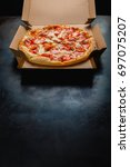 pizza in a cardboard box... | Shutterstock . vector #697075207