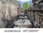 buddha statue in borobudur... | Shutterstock . vector #697100947