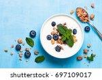 greek yogurt granola and... | Shutterstock . vector #697109017