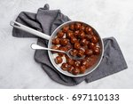 minced meat ball in tomato... | Shutterstock . vector #697110133