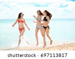 beautiful young women in bikini ... | Shutterstock . vector #697113817