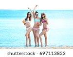 beautiful young women in bikini ... | Shutterstock . vector #697113823
