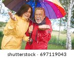 Cheerful Couple Standing In Th...