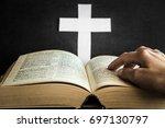 opened bible in the quiet  dark ... | Shutterstock . vector #697130797