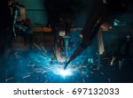 welding robots movement in a... | Shutterstock . vector #697132033