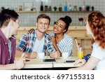 smiling young multiethnic... | Shutterstock . vector #697155313