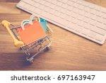 model shopping bag and shopping ... | Shutterstock . vector #697163947