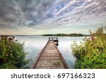 pier on big lake  beautiful sky ... | Shutterstock . vector #697166323