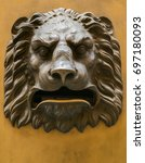 Small photo of Mailbox shaped as a lion head roaring with a fierce expression