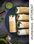 tortilla wraps with vegetables. ... | Shutterstock . vector #697198267