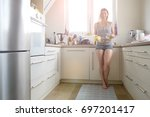 young woman washing dishes in... | Shutterstock . vector #697201417