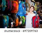 smiling female customer... | Shutterstock . vector #697209763