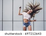 beautiful smiling teenager with ...   Shutterstock . vector #697212643