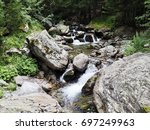 Rocky Waterfall In The Forest...